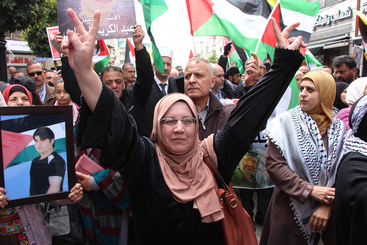 Palestinians take part in a protest to show solidarity with prisoners in Israeli jails, and marking Palestinian Prisoners' Day, in the West Bank city of Ramallah on April 17, 2019. (Photo: Ayat Arqawy/APA Images)