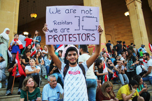 Lebanese demonstrators take part in a protest against dire economic conditions in Beirut on October 22, 2019. (Photo: Fatima Abdullah/APA Images)