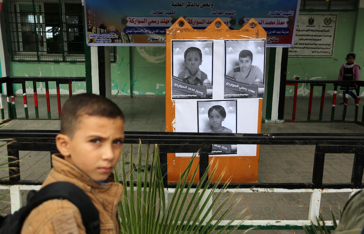 Palestinian students look on the pictures of members of Sawarka family who were killed by an Israeli airstrike, at their school, in Deir al-Balah, central of Gaza Strip on November 16, 2019. (Photo: Ashraf Amra/APA Images)