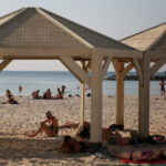 """A photo from the Haaretz article 'Sunny With a Chance of Rockets: No Casualties but Plenty of Confused Tourists in Tel Aviv' with the caption: """"The beachfront in Tel Aviv, November 12, 2019. Other than a few tourists, the area was relatively deserted — despite Tel Avivians getting an unexpected day off."""" (Photo: Daniel Bar-On/Haaretz)"""