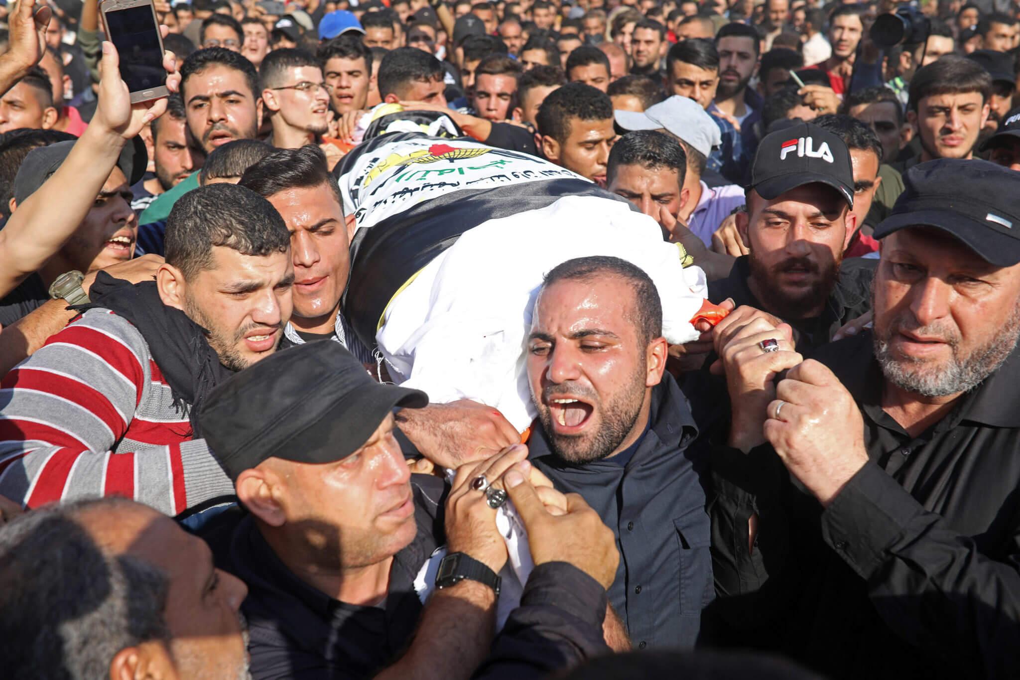 Mourners carry the body of Palestinian Islamic Jihad leader Baha Abu Al-Att a during his funeral in Gaza City, on November 12, 2019.(Photo: byMohammed Zaanoun/Activestills.org)