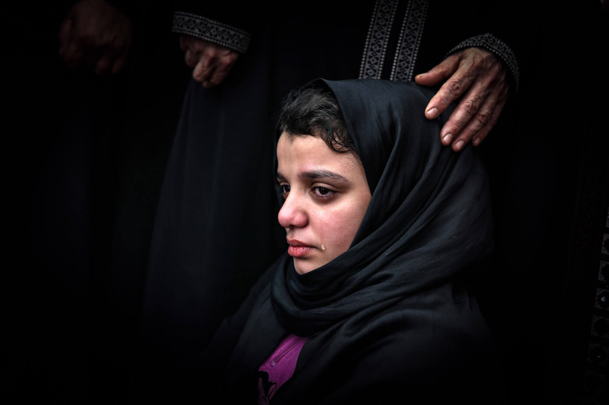 This photo taken on November 12 shows Fatma Abu al-Atta mourning during the funeral of her father, the top Islamic Jihad commander Bahaa Abu al-Atta who was killed by Israeli attack together with his wife Asma. (Photo: Mohammed Zaanoun / Activestills.org)