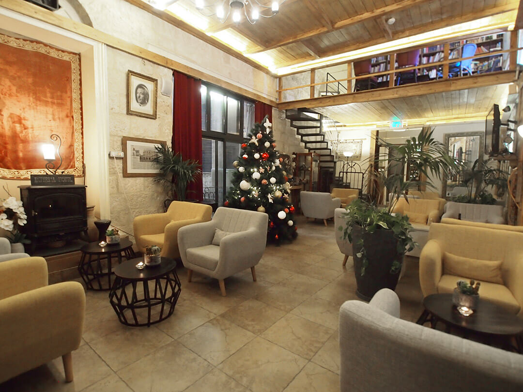Christmas tree is up in Jerusalem hotel, though hosts fear eviction by Israeli settlers
