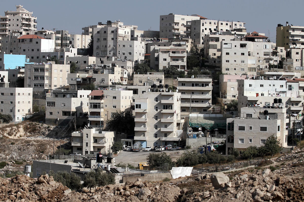 The Israeli settlement of French Hill in East Jerusalem on Sept. 09, 2013 as Israeli bulldozers began constructing a dividing zone between Issawiya and the settlement. (Photo: Saeed Qaq/ APA Images)