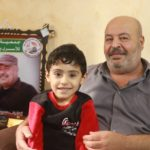 Suhail al-Amoudi with his grandson Mohammed after returning home.