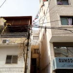Power lines in Qadura refugee camp in the West Bank city of Ramallah are spliced and shared with multiple households and shops. Although electrical service in the camps is the responsibility of the Palestinian Authority, it has not paid down the bill since 2014. (Photo: Miriam Deprez)