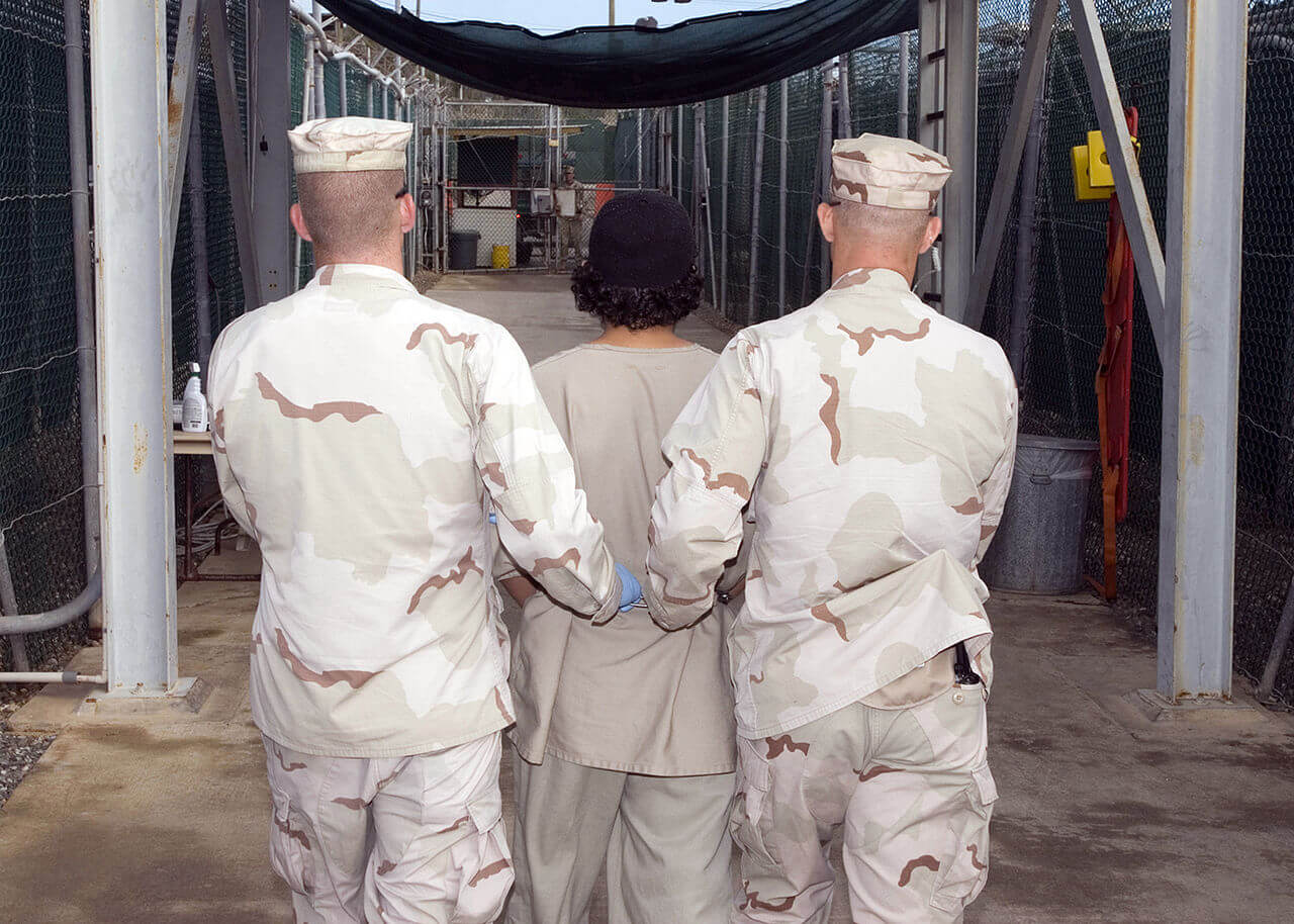 JTF Guard Force Troopers transport a detainee at a Guantanamo Bay detention facility, December 27, 2007