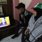 "Palestinians watch the televised press conference of President Donald Trump and Israeli Prime Minister Benjamin Netanyahu in Khan Yunis in the southern of Gaza Strip on January 28, 2020. Donald Trump announced his ""ultimate deal"" for Middle East peace, saying his plan would be a ""realistic two-state solution"" that had already been agreed to by Israel. (Photo: Ashraf Amra/APA Images"