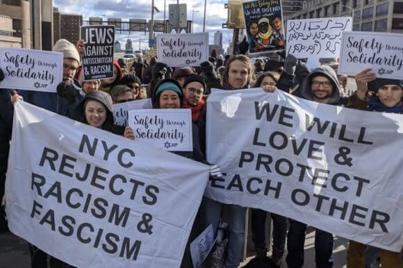 """Activists with Jewish Voice for Peace and Jews for Racial and Economic Justice at the """"No Hate, No Fear"""" march in New York City, January 5, 2020. (Photo: Twitter)"""