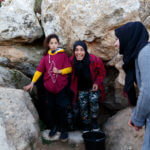 Women from a-Tuwani village fill containers with water from the Ein al-Beida spring for the first time in 15 years. (Photo: Miriam Deprez)
