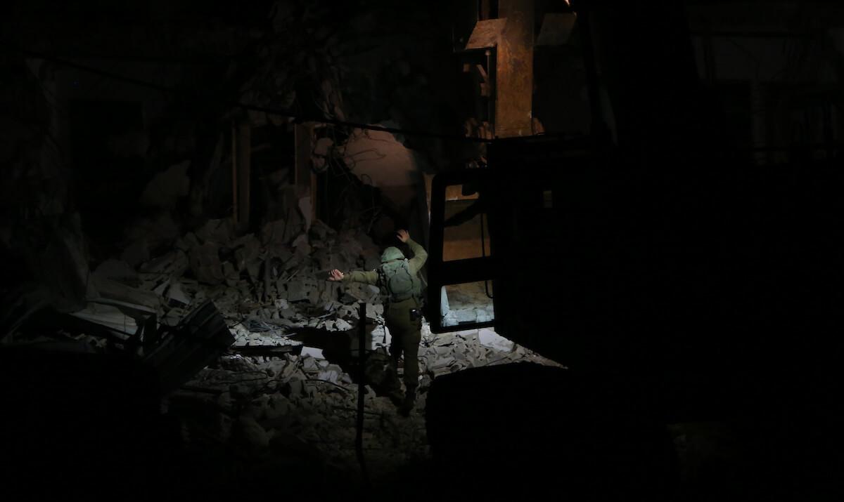 Israeli bulldozers demolish a house of Palestinian prisoner Ahmad Qunba, in the West Bank city of Jenin, on February 6, 2020. (Photo: Shadi Jarar'ah/APA Images)