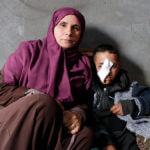 Muhammad Abu Raidah, 10, with his mother Jihan. (Photo: B'Tselem)