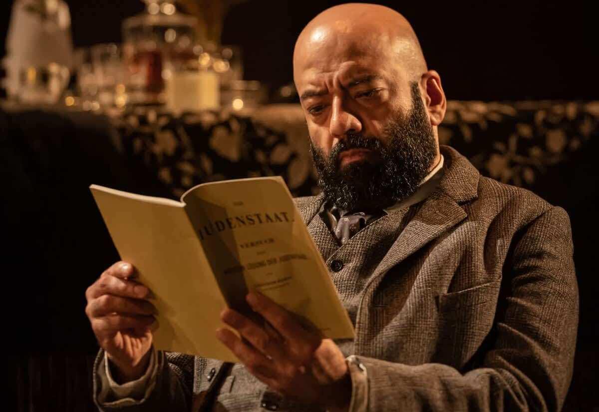 Aaron Neil's character in Tom Stoppard's new playLeopoldstadt reads Theodor Herzl's Zionist manifestoDer Judenstaat. (Photo: leopoldstadtplay.com)