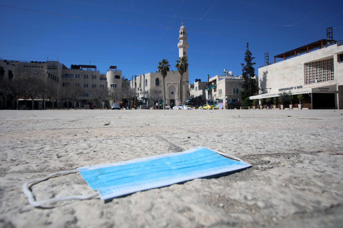 A medical mask laying in the street after preventive measures are taken against the coronavirus, in the West Bank city of Bethlehem on March 08, 2020. (Photo: Abedalrahman Hassan/ APA Images)