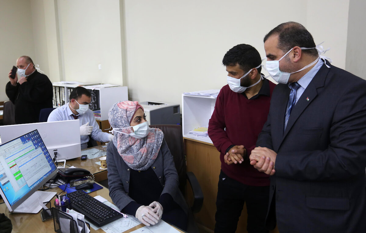 Municipal employees in Khan Younis wearing masks as a preventive measure amid fears of the spread of the coronavirus in the southern Gaza Strip on March 9, 2020. (Photo: Ashraf Amra/APA Images)
