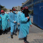 Palestinian members of the civil defense disinfect the streets as a preventive measure amid fears of the spread of the coronavirus, in Khan Younis in the southern of Gaza Strip, on March 23, 2020. (Photo: Ashraf Amra/APA Images)