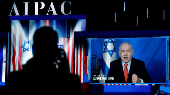 Speaking via satellite feed from Israel, Prime Minister Benjamin Netanyahu addresses the AIPAC policy conference in Washington, March 26, 2019. KEVIN LAMARQUE/ REUTERS