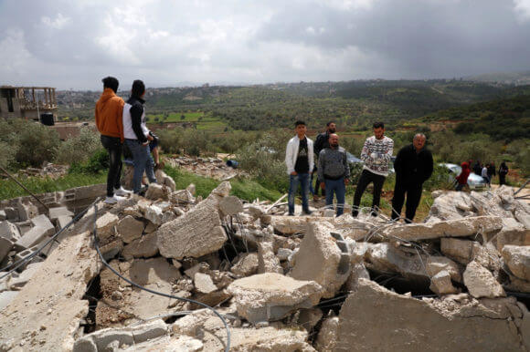 Palestinians inspect three houses demolished by Israeli forces in the village of Rummaneh, in the West Bank city of Jenin, on April 01, 2020. (Photo by Oday Deybes/ WAFA)