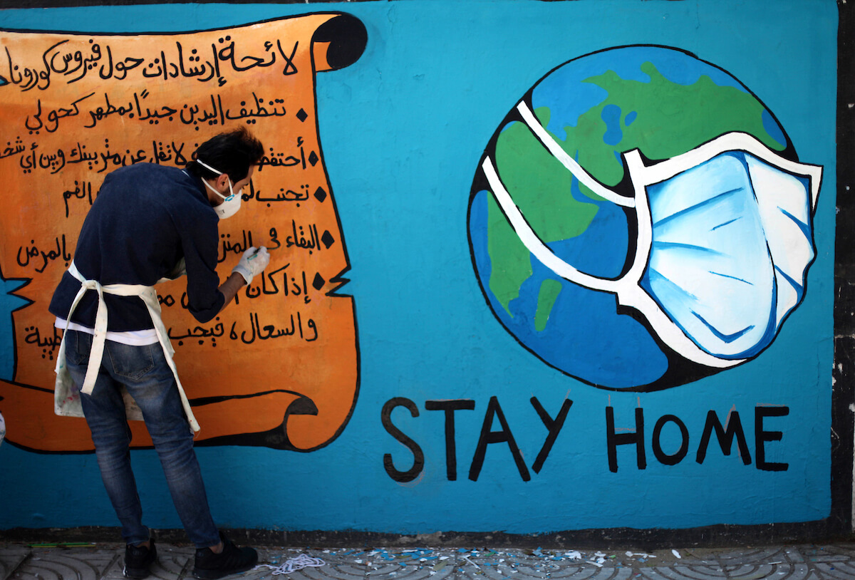 """Palestinian artists paint a """"stay home"""" mural in an awareness campaign about the spread of coronavirus disease in Gaza city, on April 2, 2020. Authorities in Gaza have said that more than 2,700 Palestinians are in home-isolation, mostly people who had returned from Egypt. (Photo: Mahmoud Ajjour/APA Images)"""