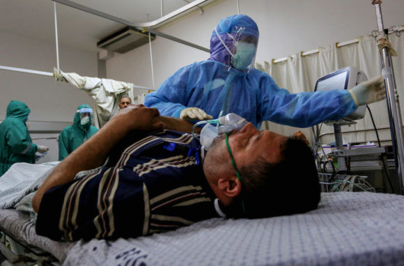 Palestinian doctors take part in a medical training that simulates treating patients with coronavirus, at the European Hospital in Khan Yunis in the southern Gaza Strip on April 6, 2020. (Photo: Ashraf Amra/APA Images)
