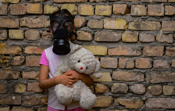 An Iraqi girl wears a mask holding a doll in her hand amid the novel coronavirus pandemic in Baghdad, Iraq, on April 9, 2020. (Photo: Anas Jomaa/APA Images)