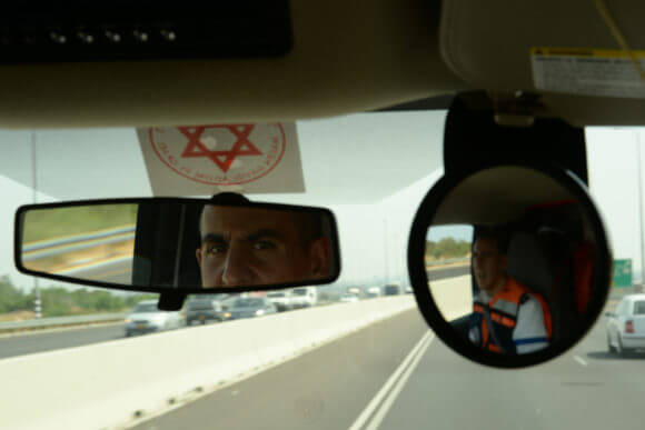 A Magen David Adom special medic glances in the rearview mirror of his ambulance during a training exercise, May 20, 2014. (Photo: U.S. Air Force photo by Staff Sgt. Joe W. McFadden/Released)