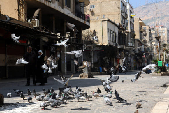 Deserted markets in Damascus, Syria, on March 22, 2020. Even though no cases of coronavirus COVID-19 have been reported in the city at that time, a lockdown was implemented. (Photo: Omar Estwani/APA Images)