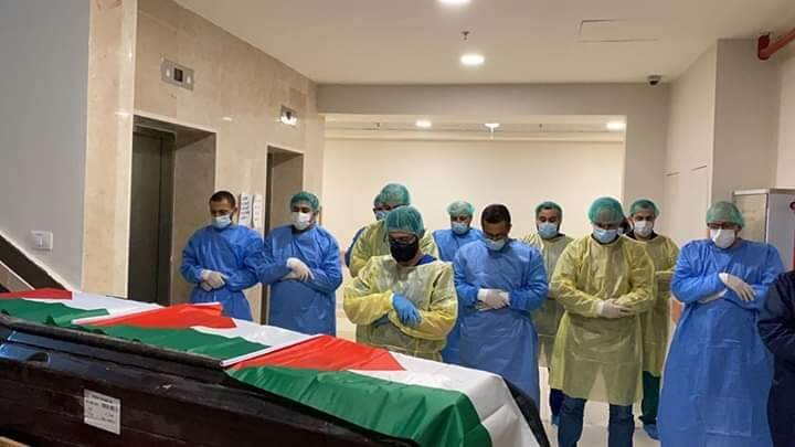 Doctors and medical staff at Hugo Chafez Hospital in Ramallah, in the occupied West Bank, perform funeral prayer to the second Palestinian who died from COVID-19. (Photo: Quds News Network)