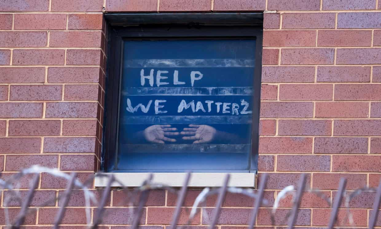 Signs pleading for help are seen in the windows at the Cook county jail complex in Chicago, Illinois, on 9 April. Photograph: Tannen Maury/EPA