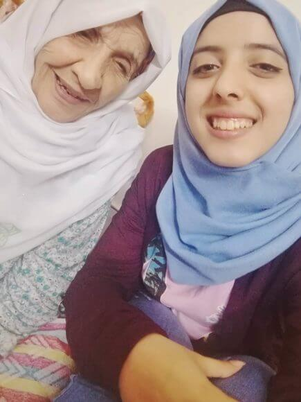 Asmaa Tayeh and her grandmother, in the Gaza Strip. (Photo: WeAreNotNumbers)