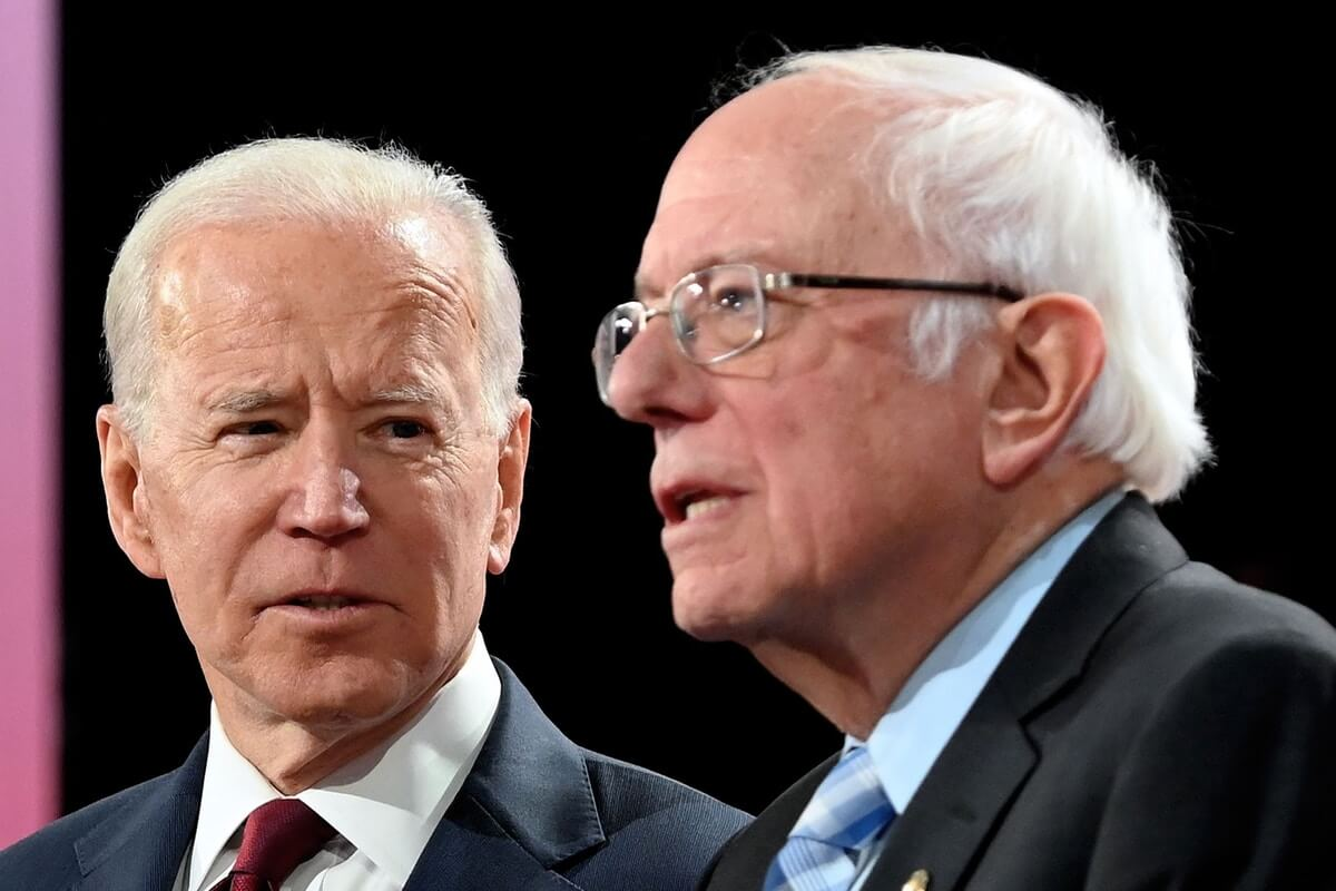 Former Vice President Joe Biden, left, and Sen. Bernie Sanders arrive onstage ahead of the sixth Democratic primary debate of the 2020 presidential campaign season in Los Angeles, Calif., on Dec. 19, 2019. (Photo: Robyn Beck/AFP)