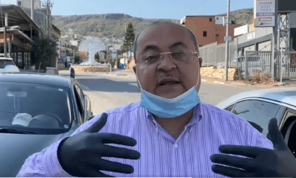 Dr. Ahmad Tibi, a member of the Israeli parliament, gives a public health briefing ahead of Ramadan. A Palestinian story invisible to the New York Times. April 18, 2020. Screenshot from twitter post.