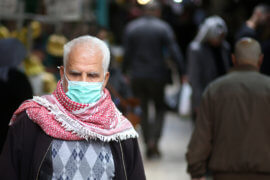 A Palestinian man wearing a protective face mask shops during the Muslim holy fasting month of Ramadan in the West Bank City of Nablus on May 09, 2020. (Photo: Shadi Jarar'ah/APA Images)