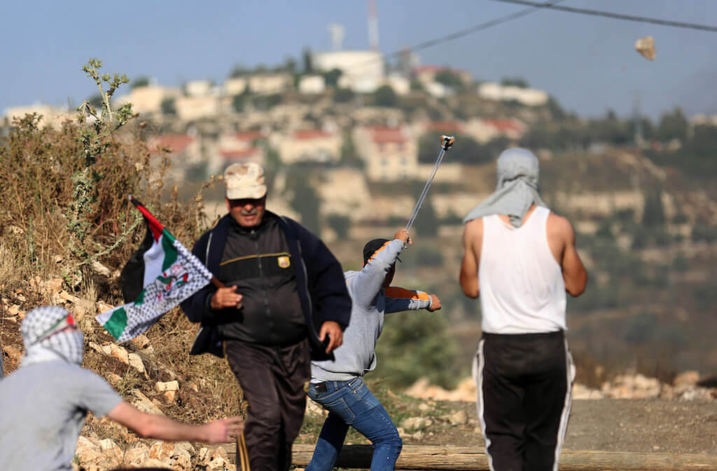 Palestinian protesters clash with Israeli forces in the West Bank village of Kafr Qaddum, east of on May 14, 2018. (Photo: Shadi Jarar'ah/APA Images)
