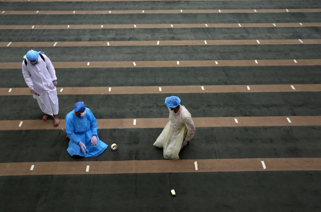Palestinian workers disinfect and prepare a mosque for prayer in Khan Younis in the southern of Gaza strip, on May 21, 2020. Photo by Ashraf Amra/APA Images