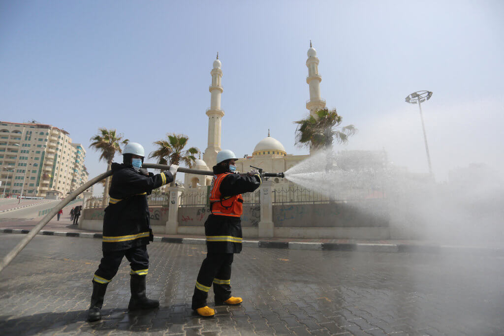 Palestinian workers disinfect the Gaza seaport, as a preventive measure amid fears of the spread of the coronavirus, in Gaza City, on March 24, 2020. (Photo: Ashraf Amra/APA Images)