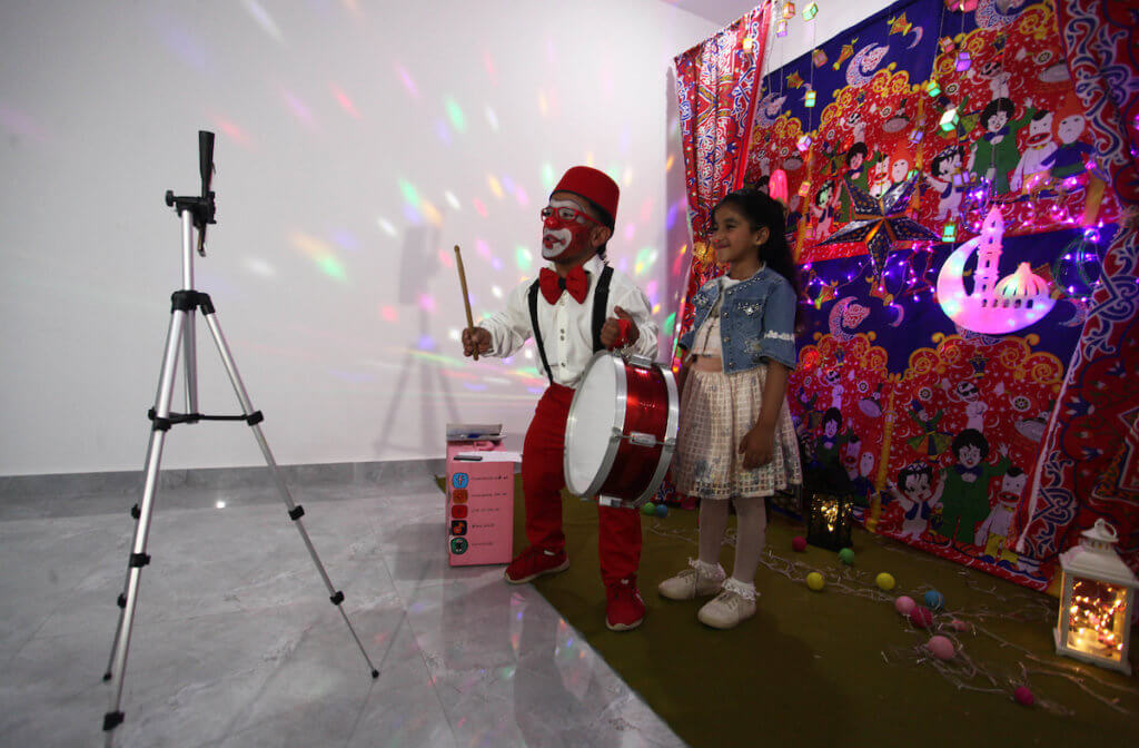 Alaa Miqdad dresses as a clown and performs for children via live broadcast from his home, to celebrate the Muslim holy month of Ramadan, in Gaza City April 25, 2020. (Photo: Mahmoud Ajjour)