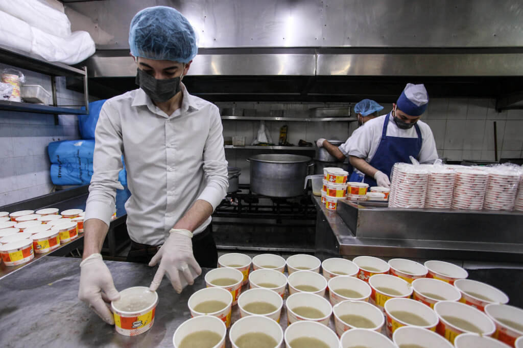 Palestinian chefs wearing protective masks prepare meals for breakfast during Ramadan for people who are in quarantine in Gaza City on April 30, 2020. (Photo: Mahmoud Ajjour/APA Images)