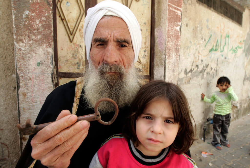 Mohamed Abdel Meguid Gomaa, a Palestinian refugee in the Rafah refugee camp, holds up a key from his family's house which they were forced from during the Nabka in 1948. (Photo: Abed Rahim Khatib/APA Images)