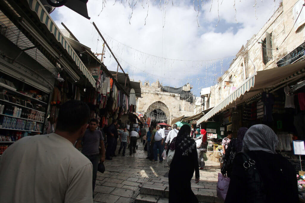 Palestinians walk in Muslim Quarter in Jerusalem's Old City on October 25, 2010. (Photo: Mahfouz Abu Turk/APA Images)