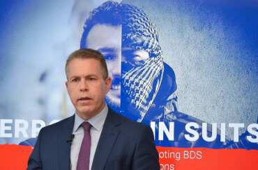 Gilad Erdan speaks during a February 2019 press conference announcing a Ministry of Strategic Affiars report on the BDS movement.