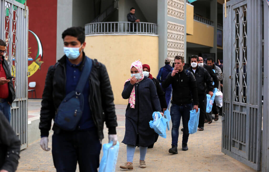 Palestinians who were quarantined leave government isolation centers, after the end of the quarantine period at a school in Khan Younis in the southern of Gaza Strip on April 5, 2020. (Photo: Ashraf Amra/APA Images)