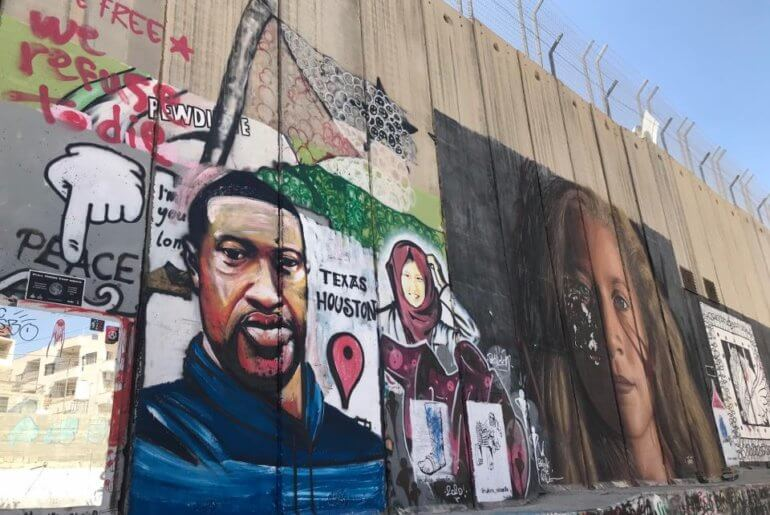 A mural of George Floyd on the Isralei Separation Wall in the occupied West Bank city of Bethlehem, June 9, 2020. Photo by Yumna Patel