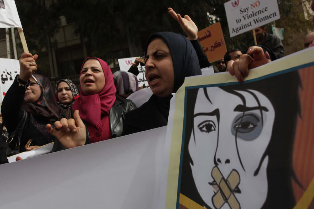 Palestinian women hold placards and shout slogans during a rally to protest against the rising incidents of violence against women in Gaza City March 03, 2014. Twenty-six women were slain by relatives in the West Bank and Gaza in 2013, twice as many as the year before. (Photo: Ashraf Amra/APA Images)