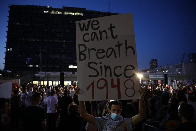 A demonstrator holds up a sign during an anti-annexation protest in Tel Aviv on June 6th, 2020. (photo: Twitter)