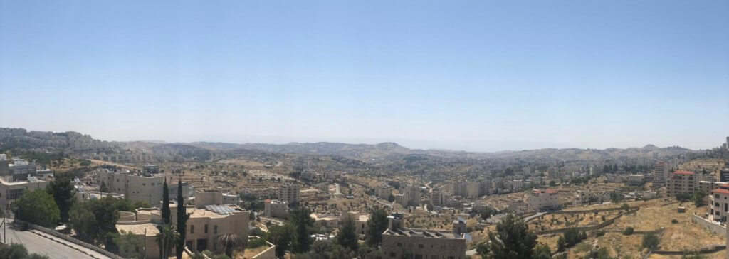 A panorama of Bethlehem. This shows a shot that is close to the one shown on the cover. Deep in the shot lies the settlements on the right and Lieberman road.