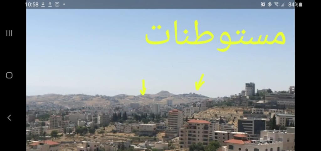 Arrows show settlements. This one shows settlements around the high mountain (Israeli touristic park) that appears on the top right of the cover image. If the angle goes to the south a bit it will show the one on the right. If the shot zooms in further in the photo it will show the settlement in the left of the mountain.