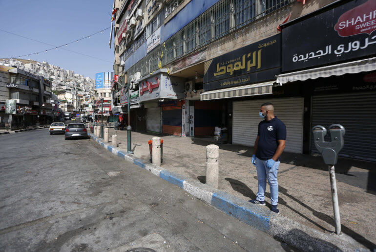 Palestinians walk in the streets during of a mandatory quarantine that was announced by the Palestinian Authority as part of measures against the resurgence of COVID-19 in the West Bank city of Nablus on June 21, 2020. (Photo: Shadi Jarar'ah/APA Images)