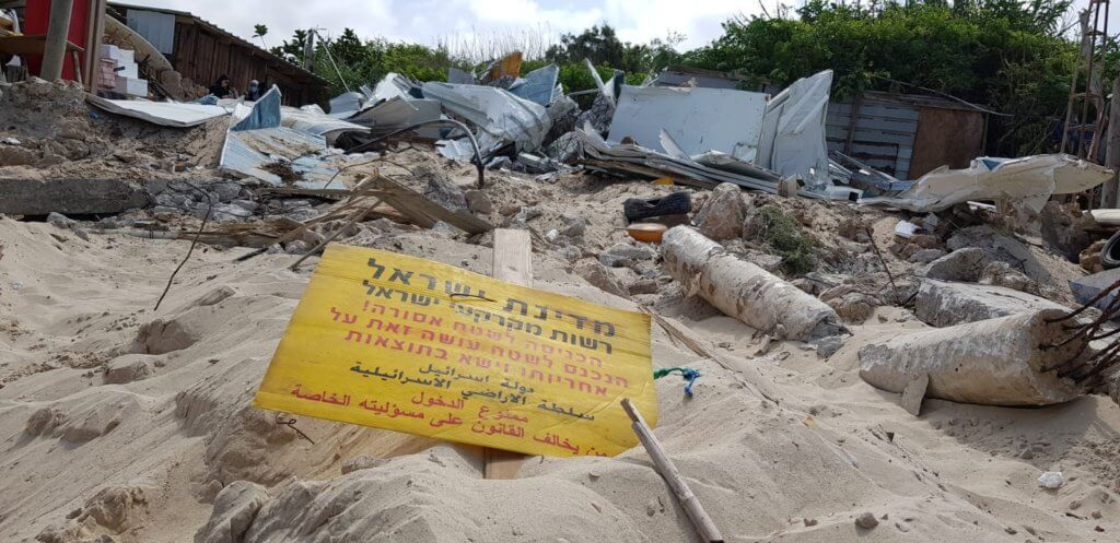 "A sign reading ""The State of Israel and Lands Administration Authority/ Entry to this area is prohibited!/ Those who enter do so under their own responsibility and will have to face the consequences"" at the demolition of Ali Jurban's fishing shack in Jisr al-Zarqa (Photo: Naim Mousa)"