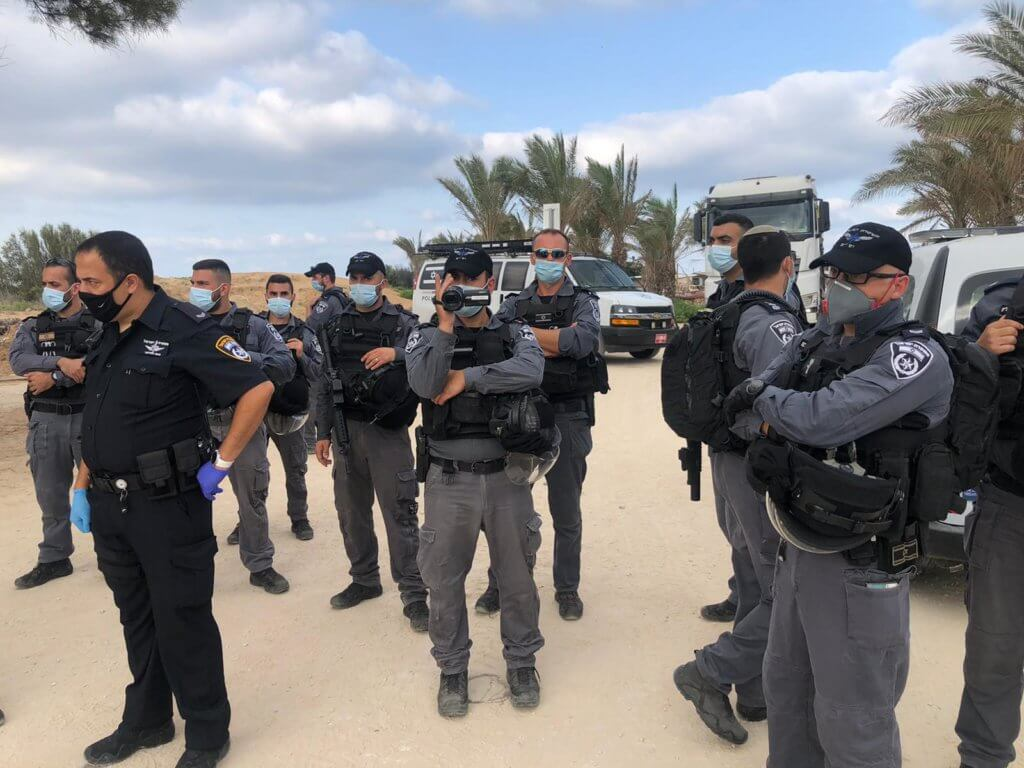 Israel Nature and Parks Authority, escorted by heavily armed police at the demolition of Ali Jurban's fishing shack in Jisr al-Zarqa (Photo: Naim Mousa)